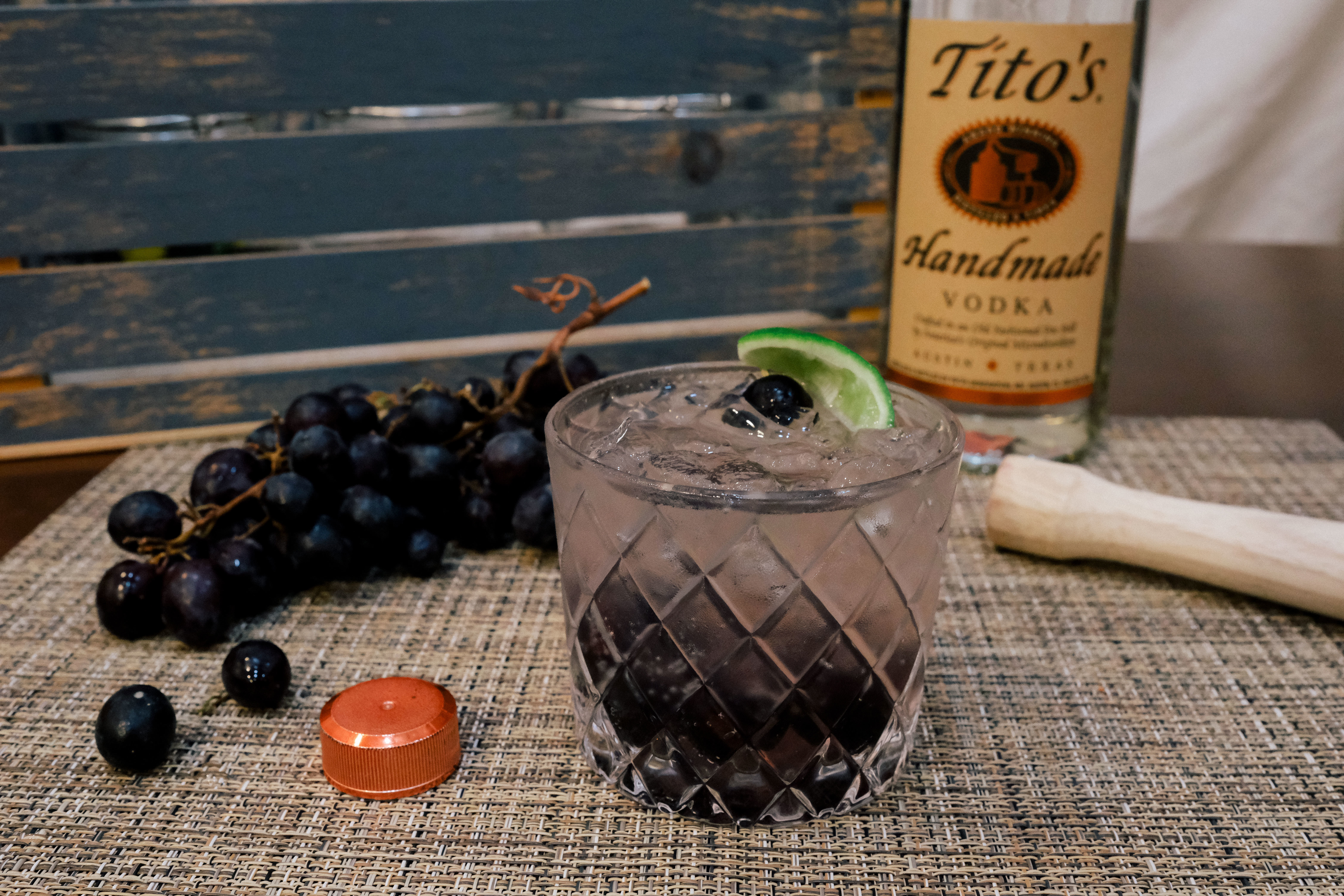 Tito's Vodka with grapes and lime cocktail