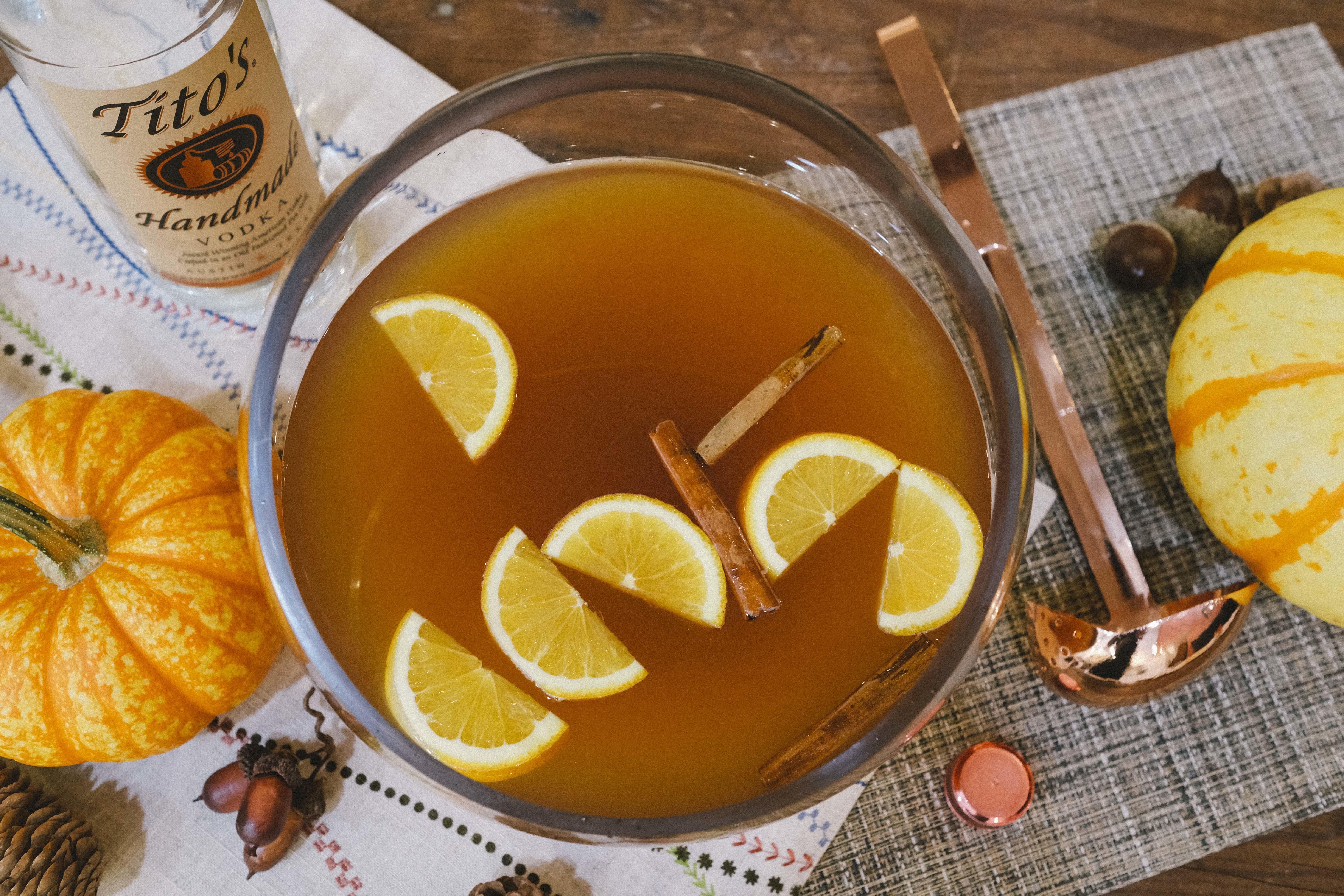 Tito's Vodka Harvest Punch cocktail with oranges and cinnamon