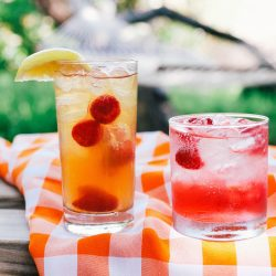 Tito's Vodka raspberry infused cocktails outside on picnic blanket