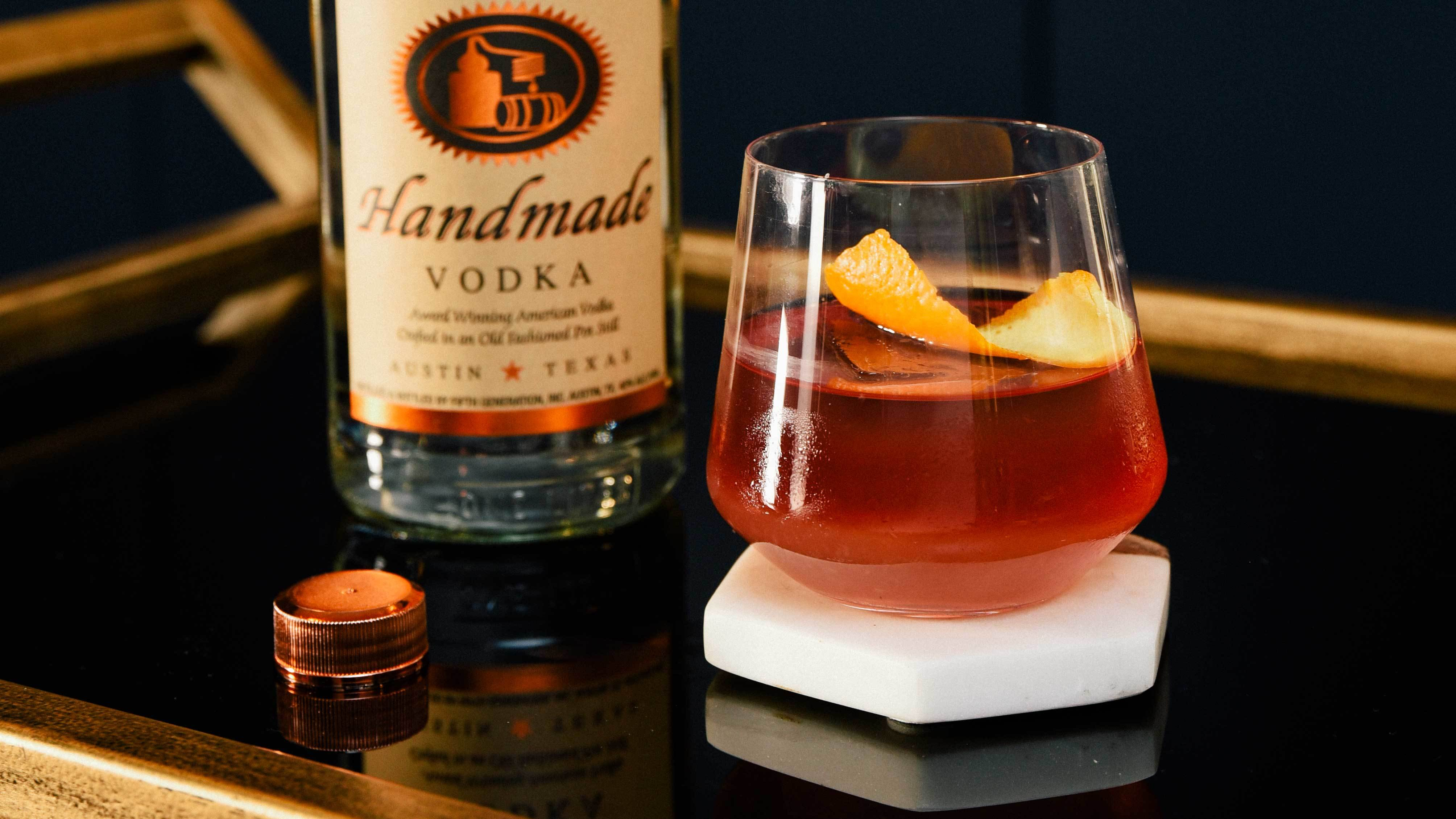 Tito's Spiced Wine Sipper garnished with an orange peel