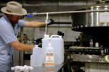 Tito's Hand Cleanser bottle filling