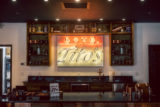 View of checkout counter and LED Love, Tito's sign