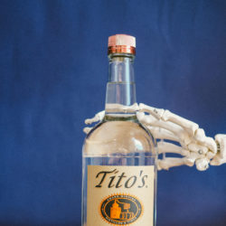 Skeleton hand on Tito's Vodka bottle