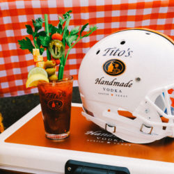 Tito's Vodka bloody mary cocktail with garnishes and football helmet