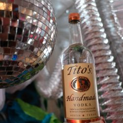 Tito's Vodka Bottle With A Disco Ball and Silver Decor