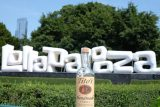 tito's vodka bottle with Lollapalooza sign