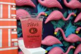 tito's vodka cocktail with flamingos