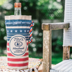 Tito's Vodka bottle inside a Tito's red, white, and blue bottle bag