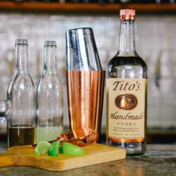 Tito's bottle with shaker set and gimlet ingredients