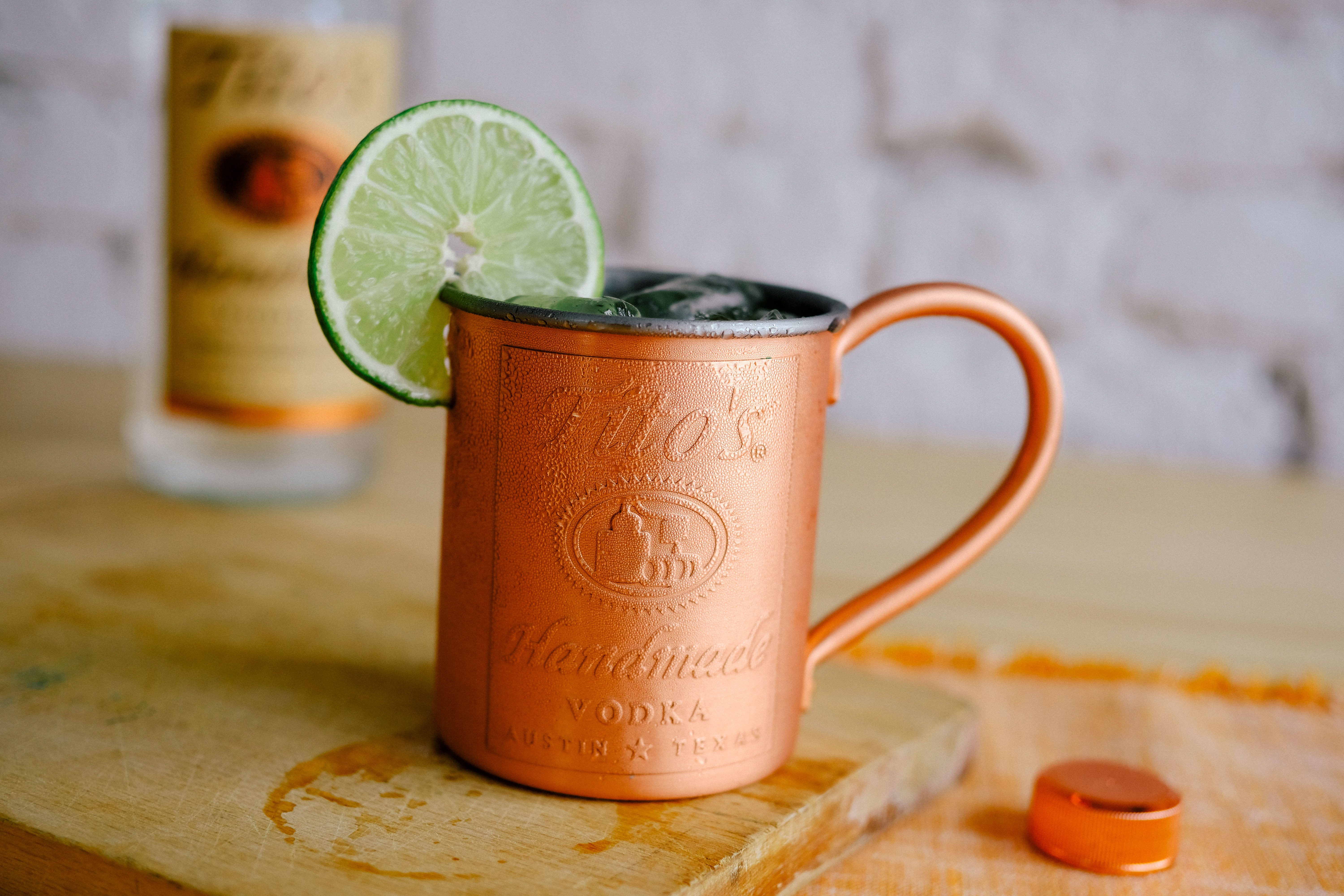 Cocktails in a Tito's Copper Mug garnished with a lime slice