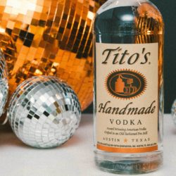 Tito's Vodka bottles surrounded by disco balls